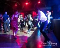 Audience members swing dance while Big Bad Voodoo Daddy performs