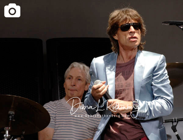 Charlie Watts and Mick Jagger of The Rolling Stones at the Performance And Press Conference To Announce Plans For Their Upcoming World Tour at Lincoln Center on May 5, 2005