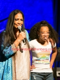 NEW YORK, NY - AUGUST 24:  (L-R) Sheila E invited 17 year old fan Kamryn Moore from Atlantic City, New Jersey up on stage for a song
