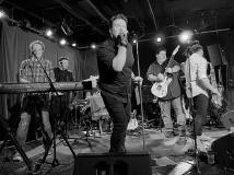 (L-R) David Turner (keyboards), Chris Rudo (bass), Sean Loughlin (lead singer, guitar) Ryan Loughlin (lead guitar) and Zack Sandler (saxophone) during a performance by The E Street Shuffle at The Wonder Bar in Asbury Park on June 26.